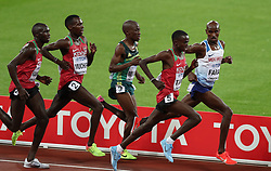 London, 2017-August-04. Mo Farah begins his break on the penultimate lap during the Men's 10,000m final at the IAAF World Championships London 2017. ©Paul Davey.