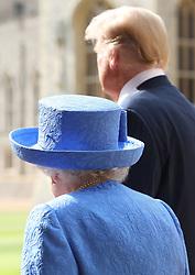 US President Donald Trump and Queen Elizabeth II walk in the Quadrangle at Windsor Castle, Windsor.