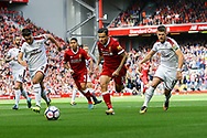 Philippe Coutinho of Liverpool (c) looks to go past Matthew Lowton and Johann Gudmundsson of Burnley. Premier League match, Liverpool v Burnley at the Anfield stadium in Liverpool, Merseyside on Saturday 16th September 2017.<br /> pic by Chris Stading, Andrew Orchard sports photography.