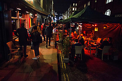 © Licensed to London News Pictures.15/12/2020. London, UK. Londoners are seen enjoying their last night of drinking in Soho, before London will go into Tier 3 on Wednesday. Photo credit: Marcin Nowak/LNP