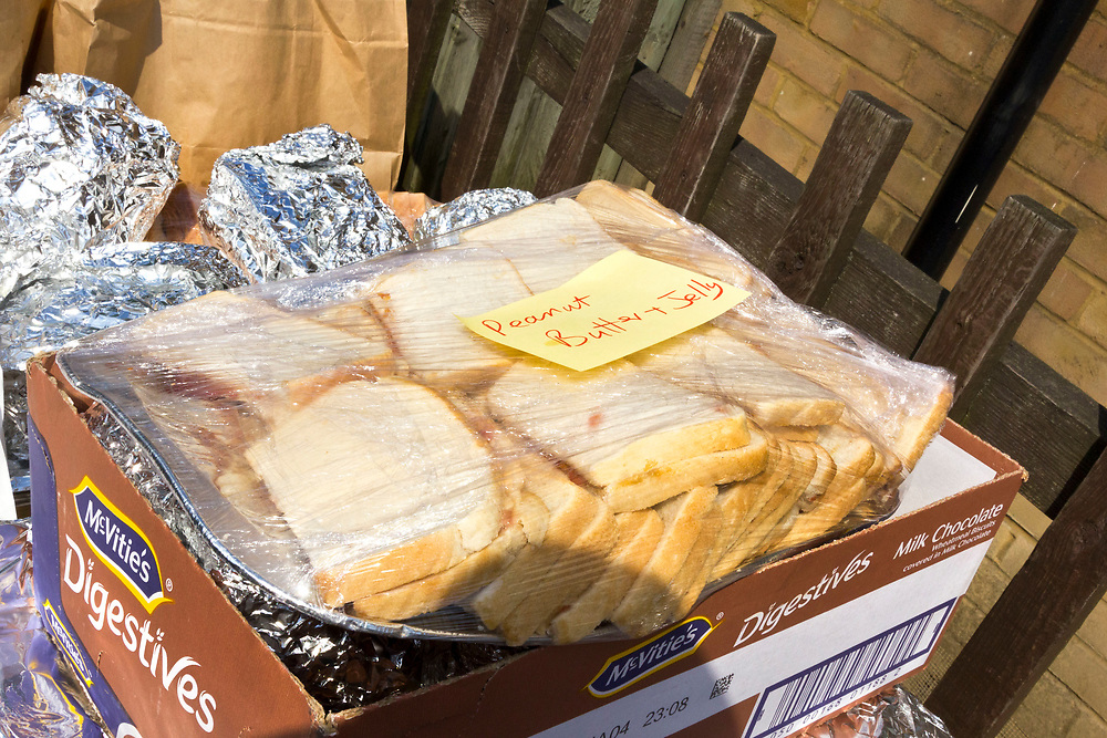 14 June 2017 taken between the hours of 12.22 - 14.49<br /> Pile of peanut and jelly sandwiches sweating in the midday sun. Donations of food and water to the various emergency centres.<br /> <br /> The Grenfell Tower fire occurred on 14 June 2017 at the 24-storey, 220-foot-high (67 m), tower block of public housing flats in North Kensington, Royal Borough of Kensington and Chelsea, West London. It caused at least 80 deaths and over 70 injuries. A definitive death toll is not expected until at least 2018. As of 5 July 2017, 21 victims had been formally identified by the Metropolitan Police. Authorities were unable to trace any surviving occupants of 23 of the flats.  ( Source Wikipedia}