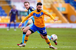 Adam May of Cambridge United puts pressure on Stephen McLaughlin of Mansfield Town - Mandatory by-line: Ryan Crockett/JMP - 20/02/2021 - FOOTBALL - One Call Stadium - Mansfield, England - Mansfield Town v Cambridge United - Sky Bet League Two