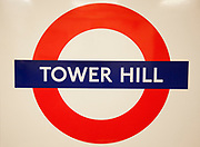 London Underground sign for Tower Hill Station. The Underground symbol is an internationally recognisable one.