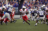Illinois State running back Pierre Rembert (5) rushes up field between Kansas State defenders Eric Childs (90) and Justin McKinney (22) in the first half, at Bill Snyder Family Stadium in Manhattan, Kansas, September 2, 2006.  The Wildcats beat the Redbirds 24-23.