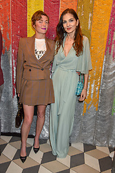 Camilla Rutherford and Yasmin Mills at a cocktail supper hosted by BOTTLETOP co-founders Cameron Saul & Oliver Wayman, along with Arizona Muse, Richard Curtis & Livia Firth to launch the #TOGETHERBAND campaign at The Quadrant Arcade on April 24, 2019 in London, England.<br /> <br /> ***For fees please contact us prior to publication***