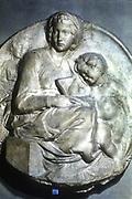 Virgin and Child. Michelangelo  (1475-1564):  Marble tondo.  Sculpture.
