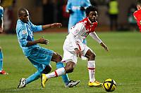 FOOTBALL - FRENCH CHAMPIONSHIP 2010/2011 - L1 - AS MONACO v OLYMPIQUE MARSEILLE - 30/01/2011 - PHOTO PHILIPPE LAURENSON / DPPI - ROD FANNI (OM) / LUKMAN HARUNA (ASM)