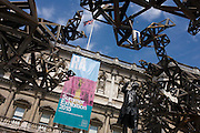 Statue of Sir Joshua Reynolds (1723-92) and Sculptor Conrad Shawcross's artwork entitled The Dappled Light of the Sun, canopy of welded-steel clouds in the Annenberg Courtyard outside the Royal Academy for the 2015 Summer Show.