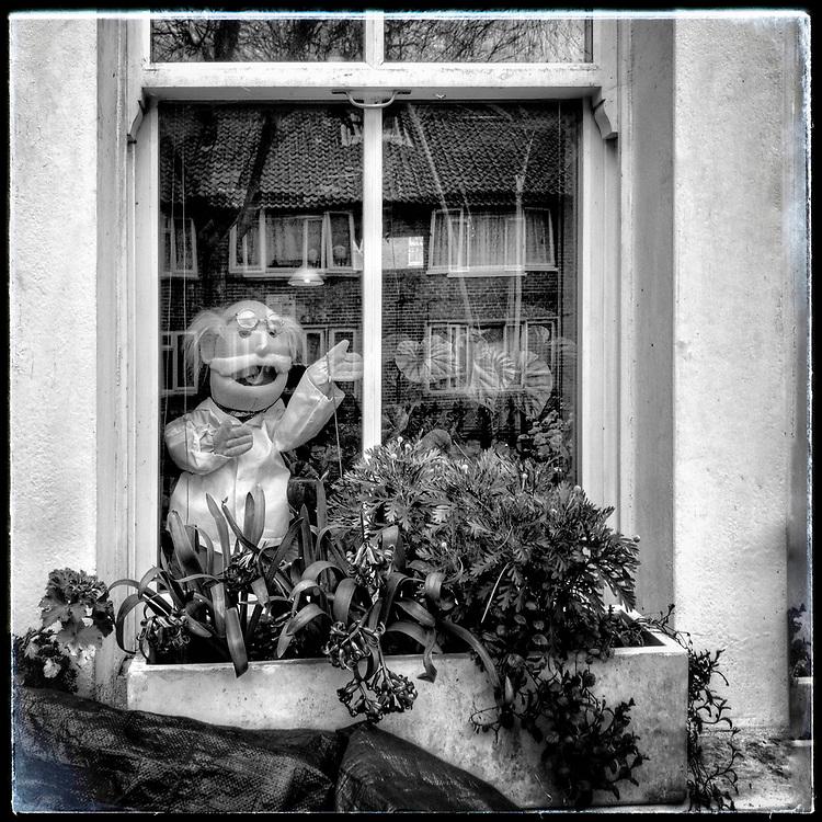 Dr Worry surveys the locked down street.  Brixton Lockdown