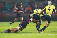 Tai Tuisamoa (L) of USA tries to stop Otar Turashvili (R) of Romania during their  rugby test match between Romania and USA, on National Stadium Arc de Triomphe in Bucharest, November 8, 2014. Romania lose the match against USA, final score 17-27.