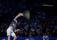 Tennis - 2019 Nitto ATP Finals at The O2 - Day Two<br /> <br /> Singles Group Andre Agassi: Daniil Medvedev vs. Stefanos Tsitsipas<br /> <br /> Stefanos Tsitsipas (Greece) on a slow  shutter speed serves  <br /> <br /> COLORSPORT/DANIEL BEARHAM<br /> <br /> COLORSPORT/DANIEL BEARHAM