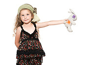 caucasian little girl showing rabbit cuddly toy isolated studio on white background