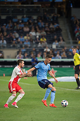 May 31, 2017 - New York City FC defender BEN SWEAT (2) defends the ball against New England Revolution forward DIEGO FAGUNDEZ (14) at Yankee Stadium in Bronx, NY. (Credit Image: © Mark Smith via ZUMA Wire)