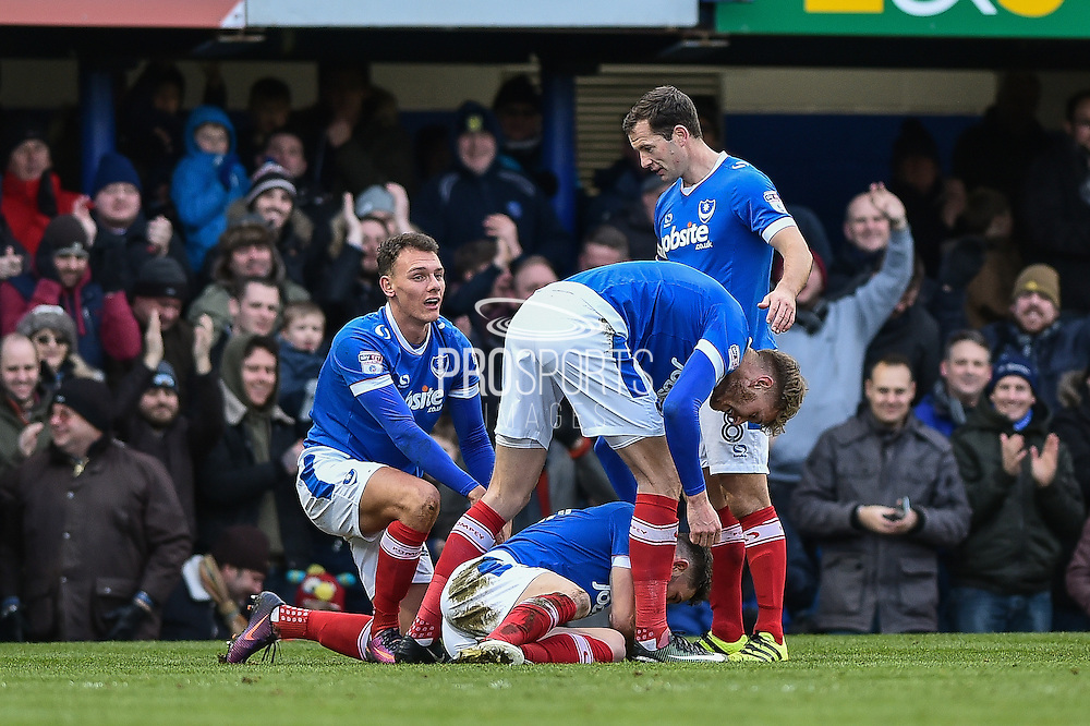Portsmouth Players Celebrate after Portsmouth Forward, Conor Chaplin (19) opens the scoring goal 1-0 during the EFL Sky Bet League 2 match between Portsmouth and Leyton Orient at Fratton Park, Portsmouth, England on 14 January 2017. Photo by Adam Rivers.