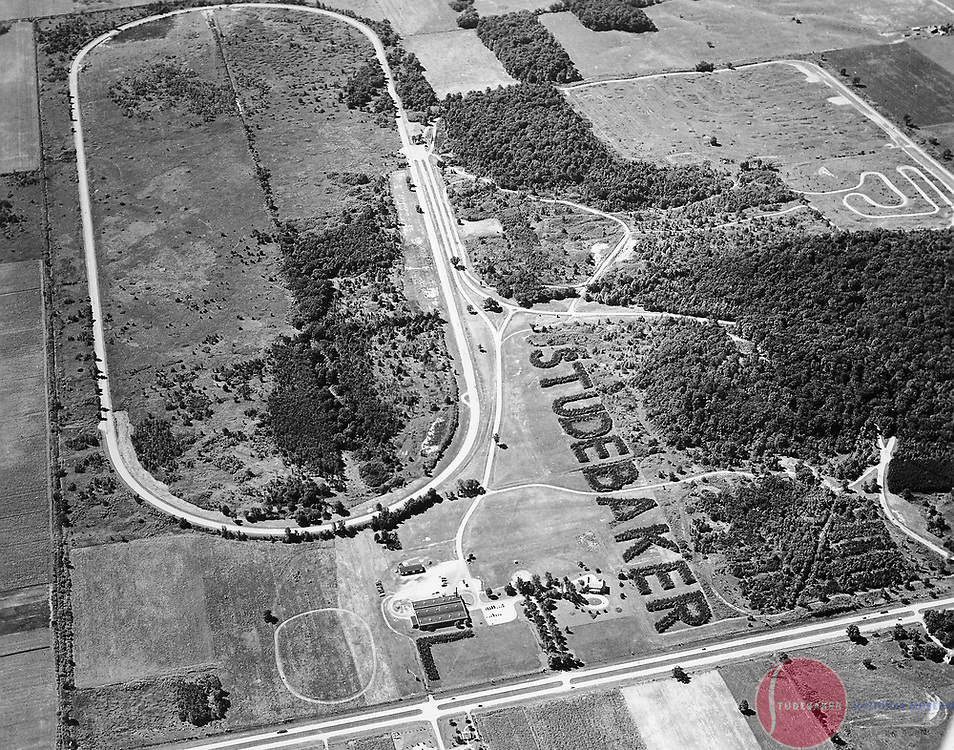 The Studebaker Corporation's Proving Ground featured the worlds largest living sign. It was planted in the late 1930s, and remains visible today as part of St. Joseph County's Bendix Woods County Park.