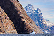 The towering peak of Grundtvigskirken, in O Fjord, Scoresby Sund, Greenland.