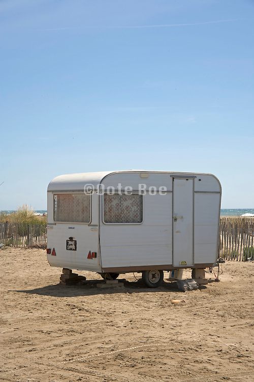 single old camper parked by the beach
