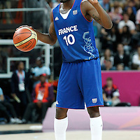 04 August 2012: France Yannick Bokolo sets the offense during 73-69 Team France victory over Team Tunisia, during the men's basketball preliminary, at the Basketball Arena, in London, Great Britain.