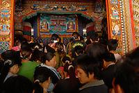 Advertising intrudes in Tibetan life, Sichuan, China