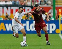 Photo: Glyn Thomas.<br />Portugal v Iran. Group D, FIFA World Cup 2006. 17/06/2006.<br /> Portugal's Luis Figo (R) and Iran's Hossein Kaabi.