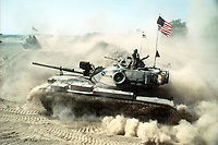USMC Patton tanks on manoeuvres in the desert. Photograph by Terry Fincher