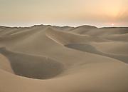 Sunset over the sand dunes in the Lut Desert.
