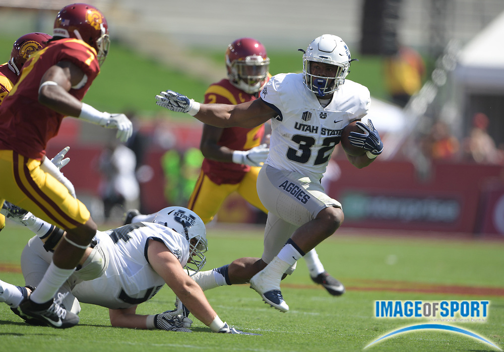 Sep 10, 2016; Los Angeles, CA, USA; Utah State Aggies running back Devante Mays (32) carries the ball against the USC Trojans during a NCAA football game at Los Angeles Memorial Coliseum.