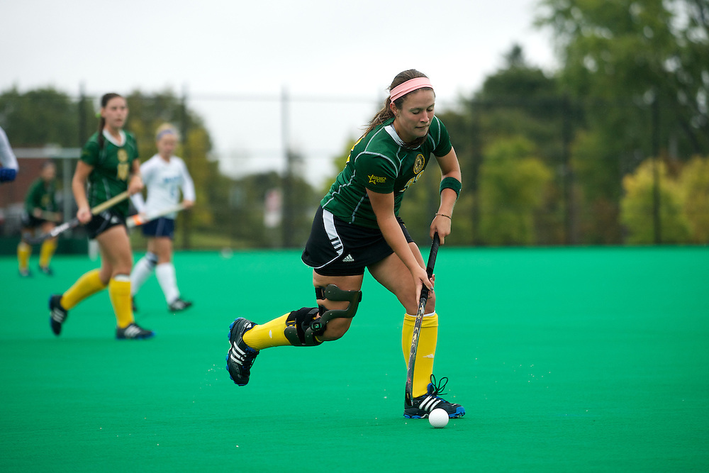 Catamounts midfielder Angie DeBellis (23) runs down the field with the ball during the women's field hockey game between the Maine Black Bears and the Vermont Catamounts at Moulton/Winder Field on Saturday afternoon September 29, 2012 in Burlington, Vermont.