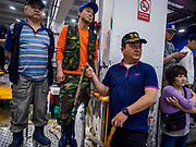 07 JUNE 2018 - SEOUL, SOUTH KOREA:  An auction worker holds up fish being auctioned off in the Noryangjin Fish Market. The auctions start about 01.00 AM and last until 05.00 AM. Noryangjin Fish Market is the largest fish market in Seoul and has been in operation since 1927. It opened in the current location in 1971 and was renovated in 2015. The market serves both retail and wholesale customers and has become a tourist attraction in recent years.    PHOTO BY JACK KURTZ