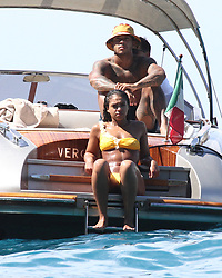 "EXCLUSIVE: Memphis Depay and fiancee Lori Harvey enjoying a trip on Dolce & Gabbana's boat ""Vergine Maria"". 13 Aug 2017 Pictured: Lori Harvey, Memphis Depay. Photo credit: Ceres / MEGA TheMegaAgency.com +1 888 505 6342"