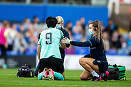 Brighton & Hove Albion forward  Lee Geum-Min (9) injured during the FA Women's Super League match between Birmingham City Women and Brighton and Hove Albion Women at St Andrews, Birmingham United Kingdom on 12 September 2021.