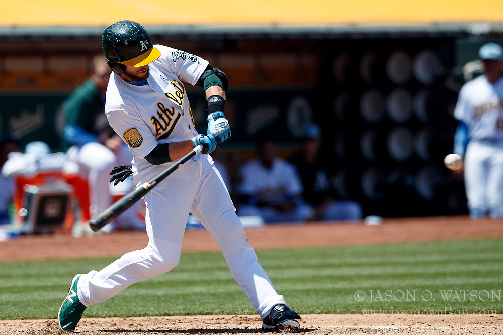 OAKLAND, CA - JUNE 17: Jed Lowrie #8 of the Oakland Athletics at bat against the Los Angeles Angels of Anaheim during the fourth inning at the Oakland Coliseum on June 17, 2018 in Oakland, California. The Oakland Athletics defeated the Los Angeles Angels of Anaheim 6-5 in 11 innings. (Photo by Jason O. Watson/Getty Images) *** Local Caption *** Jed Lowrie