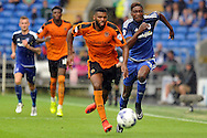 Wolves' Ethan Ebanks-Landell (c) is chased by Cardiff City's Sammy Ameobi (r). Skybet football league championship match, Cardiff city v Wolverhampton Wanderers at the Cardiff city stadium in Cardiff, South Wales on Saturday 22nd August 2015.<br /> pic by Carl Robertson, Andrew Orchard sports photography.
