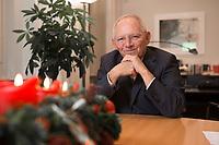 17 DEC 2014, BERLIN/GERMANY:<br /> Wolfgang Schaeuble, CDU, Bundesfinanzminister, mit Weihnachtsgesteck nach einem Interview, in seinem Buero, Bundesministerium der Finanzen<br /> IMAGE: 20141217-01-020<br /> KEYWORDS: Wolfgang Schäuble