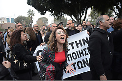 Demonstrators outside parliament in Nicosia,  Cyprus, where politicians gathered to discuss austerity cuts for Cyprus, March 21, 2013. Photo By Nick Cornish / i-Images.