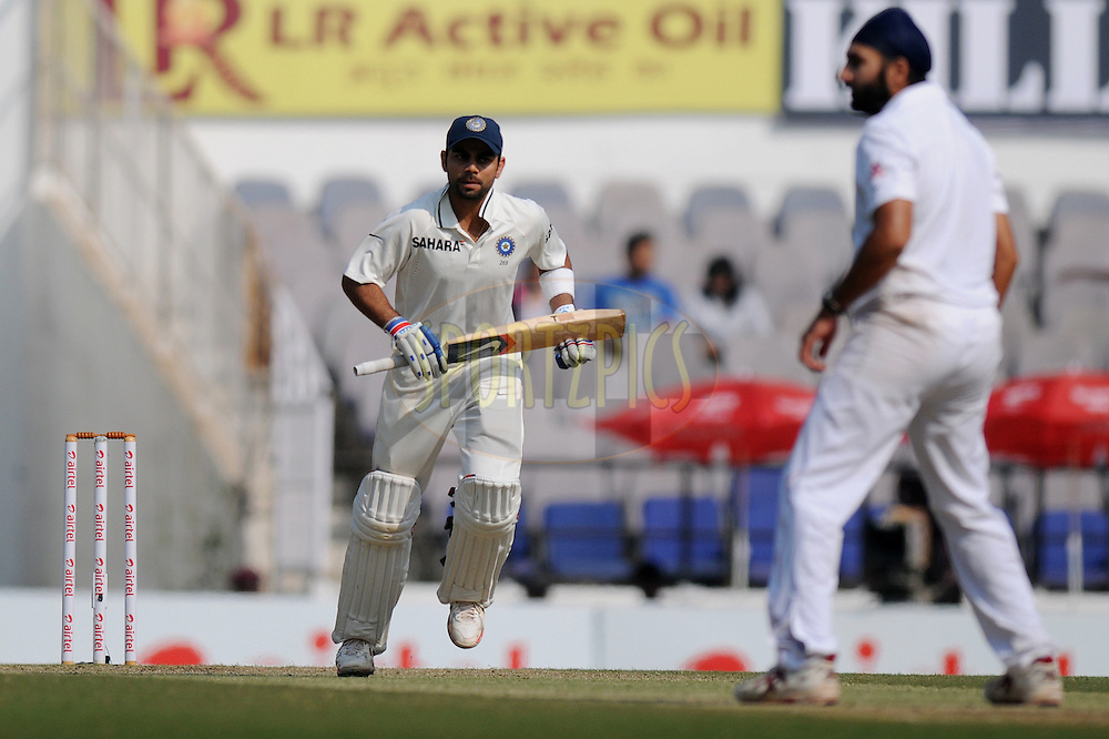 Virat Kohli of India runs between the wicket during day three of the 4th Airtel Test Match between India and England held at VCA ground in Nagpur on the 15th December 2012..Photo by  Pal Pillai/BCCI/SPORTZPICS ..
