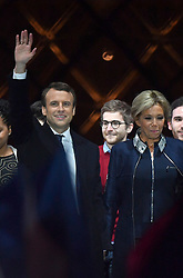 Emmanuel Macron is surrounded on stage by wife Brigitte and family members after winning the French presidential election, at the Louvre Pyramid in Paris, France on May 7, 2017. Macron, a 39-year-old pro-business centrist, defeated Marine Le Pen, a far-right nationalist who called for France to exit the European Union, by a margin of 65.5% to 34.1%, becoming the youngest president in France's history. Photo by Christian Liewig/ABACAPRESS.COM