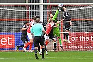 Crawley Town goalkeeper Glenn Morris (1) punches away a corner during the EFL Sky Bet League 2 match between Cheltenham Town and Crawley Town at Jonny Rocks Stadium, Cheltenham, England on 10 October 2020.