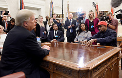 File photo dated October 11, 2018 of U.S. President Donald Trump (L) hosts working lunch with artist Kanye West (R) to discuss criminal justice system and prison reform in the Oval Office of the White House in Washington, DC. US rapper Kanye West took to Twitter over the weekend to announce he was running for president, with his declaration quickly going viral and prompting a flurry of speculation. His wife Kim Kardashian West and entrepreneur Elon Musk endorsed him. Photo by Olivier Douliery/ Abaca Press