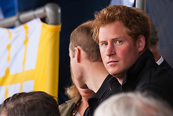 Lee Valley Athletic Centre, London, September 11th 2014. Prince Harry, a major force behind the invictus games attend the track and field competition in London ath the Lee Valley Athletics Centre.
