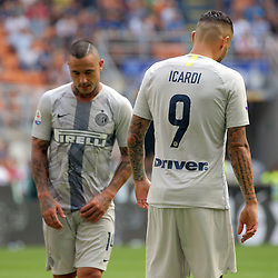 September 15, 2018 - Milan, Milan, Italy - Mauro Icardi #9 of FC Internazionale Milano and Radja Nainggolan #14 of FC Internazionale Milano reacts to a missed chance during the serie A match between FC Internazionale and Parma Calcio 1913 at Stadio Giuseppe Meazza on September 15, 2018 in Milan, Italy. (Credit Image: © Giuseppe Cottini/NurPhoto/ZUMA Press)