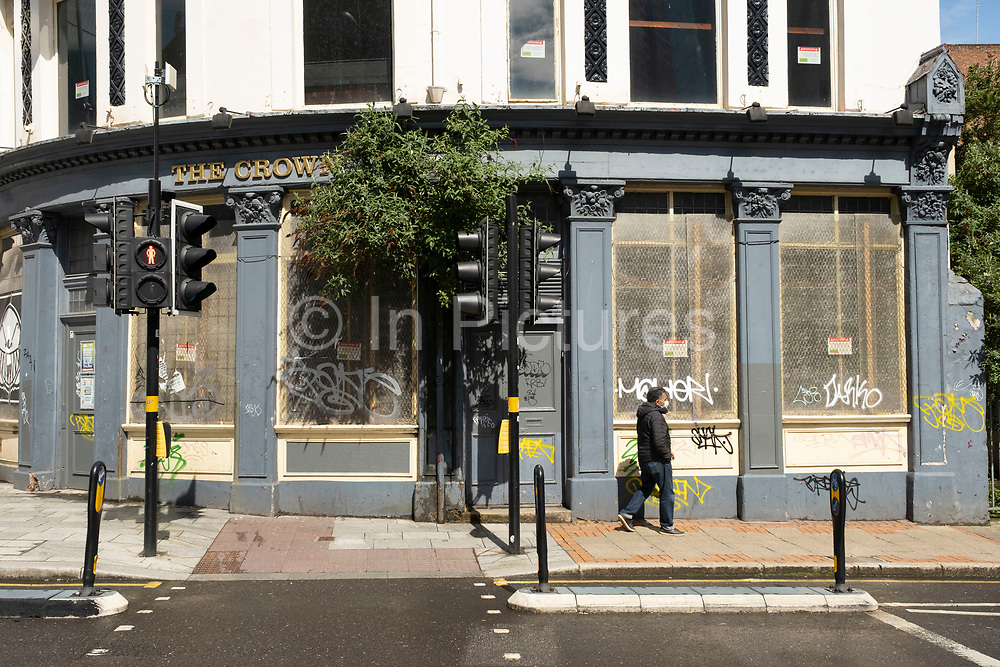 Boarded up pub as the coronavirus restrictions continue the process of easing, more people begin to come to the city centre on 18th May 2021 in Birmingham, United Kingdom. After months of lockdown, the first signs that life will start to get back to normal begin, with more people enjoying the company of others in public, as the rule of six starts the first stage of lockdown ending.