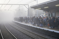 © Licensed to London News Pictures. 06/02/2020. London, UK. Commuters on a platform at a north London overground station in freezing and foggy conditions. Photo credit: Dinendra Haria/LNP