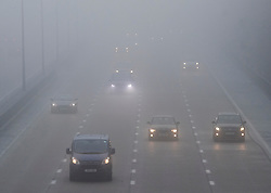 © Licensed to London News Pictures. 30/12/2016. Dorking, UK. Vehicles on the M25 in Surrey on another day of fog and freezing temperatures. Photo credit: Peter Macdiarmid/LNP