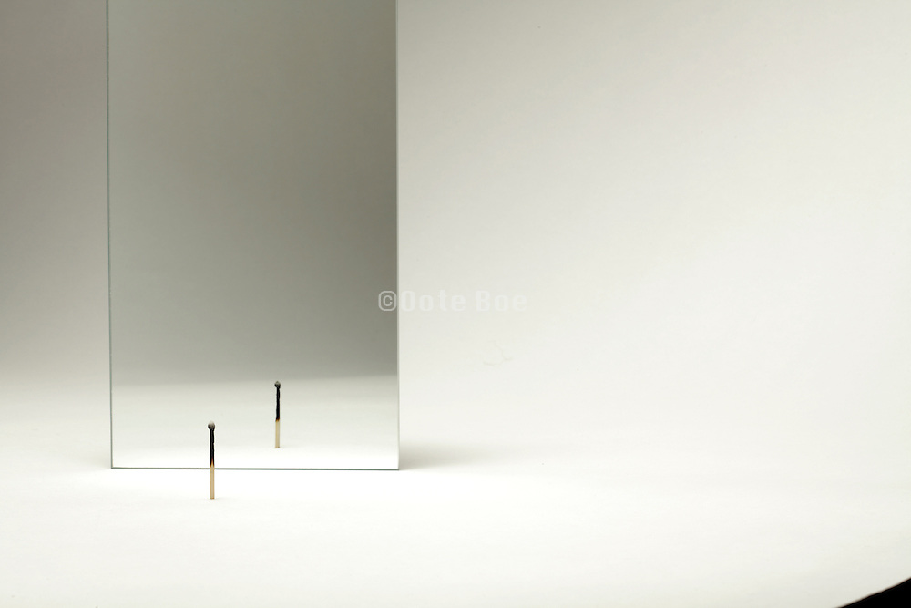 mirror with burned matchstick