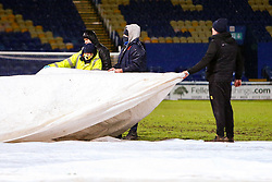 Mansfield Town ground staff pull tarpaulin sheets over the pitch at full time - Mandatory by-line: Ryan Crockett/JMP - 17/02/2021 - FOOTBALL - One Call Stadium - Mansfield, England - Mansfield Town v Bolton Wanderers - Sky Bet League Two