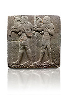 Hittite monumental relief sculpted orthostat stone panel of a Procession Basalt, Karkamıs, (Kargamıs), Carchemish (Karkemish), 900-700 B.C.  Anatolian Civilisations Museum, Ankara, Turkey. Young male servants of Kubaba while carrying sacrificial animals on their shoulders. <br /> <br /> Against a white background. .<br />  <br /> If you prefer to buy from our ALAMY STOCK LIBRARY page at https://www.alamy.com/portfolio/paul-williams-funkystock/hittite-art-antiquities.html  - Type  Karkamıs in LOWER SEARCH WITHIN GALLERY box. Refine search by adding background colour, place, museum etc<br /> <br /> Visit our HITTITE PHOTO COLLECTIONS for more photos to download or buy as wall art prints https://funkystock.photoshelter.com/gallery-collection/The-Hittites-Art-Artefacts-Antiquities-Historic-Sites-Pictures-Images-of/C0000NUBSMhSc3Oo
