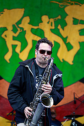 03 May 2013. New Orleans, Louisiana,  USA. .New Orleans Jazz and Heritage Festival. .Jason Mingledorff plays with Papa Grows Funk..Photo; Charlie Varley.