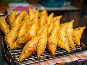 28 MAY 2018 - BANGKOK, THAILAND: Fresh cooked somosas (an Indian snack popular in Myanmar) for sale in Phra Khanong Market in Bangkok. The market serves a mix of Thai working class people and immigrants from Myanmar (Burma).     PHOTO BY JACK KURTZ