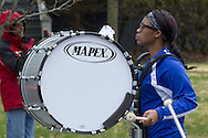 Middletown, New York - A drummer in the Middletown High School Marching Middies band marches down the street during the 60th annual Middletown Little League parade on April 14, 2013.